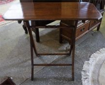 A Late Victorian Mahogany Folding Occasional Table, with rectangular top, raised on shaped
