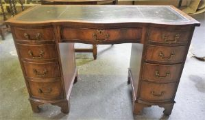 A Mahogany Kneehole Desk, with tooled green leather skiver above a central drawer and flanked with
