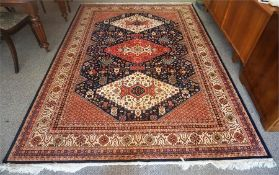 A Kashmir Machine Made Rug, Decorated with three large Geometric medallions to the centre, with