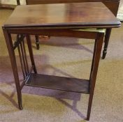 An Edwardian Mahogany Folding Card Table, with a swivel top enclosing a green felt lined interior,
