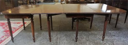 An Antique Mahogany D- End Dining Table, with one additional leaf, raised on ring turned spindle