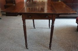 A Regency Mahogany Pembroke Table, circa early 19th century, with a drawer to one side with opposing