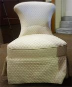 A Victorian Mahogany Nursing Chair, upholstered in later white fabric, raised on turned reeded