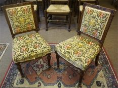 A Pair Of Victorian Mahogany Dining Chairs, Upholstered in later colourful floral fabric, raised