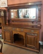 An Arts & Crafts Mahogany Mirrorback Sideboard, The large mirorback is raised on reeded columns