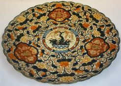 A Large Japanese Imari Platter, Meiji period, circa late 19th century, decorated with all over