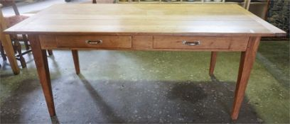 A Farmhouse Pine Table, The rectangular top with two drawers, raised on tapered legs, 75cm high,