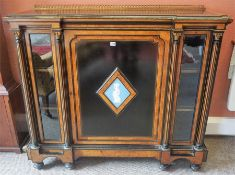 A Victorian Ebonised & Amboyna Breakfront Credenza, with a gilt metal gellery back above a central