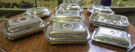 A Quantity Of Silver Plated Entree Dishes, with associated covers, four screw handles, and two spare
