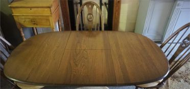 An Ercol Extending Dining Table With Four Matching Chairs, (dining table 73cm high, 150cm long, 91cm