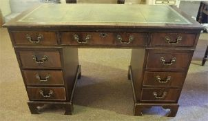 A Reproduction Mahogany Kneehole Desk, with a tooled green leather skiver above a large drawer