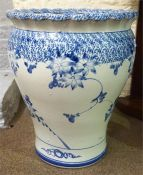 A Large Delft Style Blue & White Pottery Planter, Decorated with floral panels, 50cm high