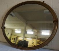 A Large Antique Gilt Framed Overmantel Mirror, Of oval form, decorated with floral roundels, 113cm