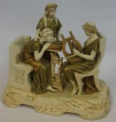 A Large Porcelain Figure Group By Royal Dux, Modelled as three classical females, one playing the