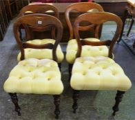 A Set Of Four Stained Mahogany Balloon Back Dining Chairs