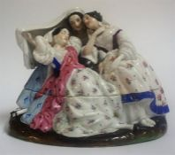 A Continental Porcelain Inkwell, circa late 19th century, in the form of three females, in two