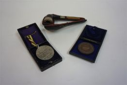 A Sterling Silver Banded Smoking Pipe, with amber coloured stem, a/f, also with a cricket medal