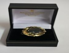 A 9ct Gold Citrine Cocktail Ring, the large citrine stone is approximately 2.2 cm diameter,