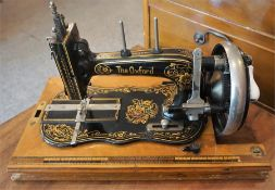 The Oxford Sewing Machine, Made in Saxony, 20cm high, with cover
