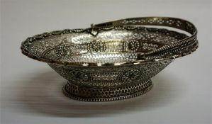 A Silver Bon-Bon Basket, Hallmarks for Lionel Alfred Crichton, London 1912, with swing handle and