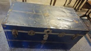 A Vintage Blue Painted Metal Travel Trunk, with a hinged top, 53cm high, 102cm wide, 54cm deep
