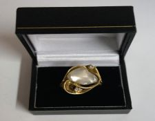 A 14k Gold Mother Of Pearl & Diamond Ring, with a large Mother of Pearl stone measuring