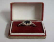 An 18ct Gold Sapphire & Diamond Cluster Ring, overall weight 4.5 grams