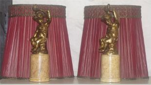 A Pair Of Antique Gilded Putti Figures, converted from gas lights, raised on a cylindrical wood