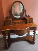 A Victorian Mahogany Dressing Table, with swing mirror above fitted drawers and large drawer, with