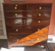A Georgian Mahogany Chest Of Drawers, with two small drawers above four graduated drawers, with
