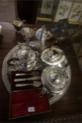 A Quantity Of Silver Plated Wares, to include a Georgian style coffee pot, glass claret jug with a