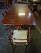 A Reproduction Mahogany Twin Pillar Dining table With Eight Dining Chairs, in the Regency style,