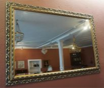 A Modern Gilt Framed Wall Mirror, 74cm high, 105cm wide