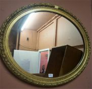Two Gilt Framed Wall Mirrors, of square and oval form, 49, 66cm wide, (2)