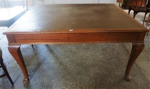 A Mahogany Centre Table, with a leather tooled surface, raised on pad foot, 77cm high, 123cm wide,