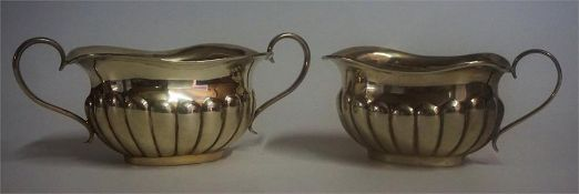 A Silver Cream Jug With Matching Sugar Bowl, Hallmarks for Birmingham 1938, 5cm high, overall weight