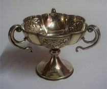 An Edwardian Silver Three Handled Cup, Hallmarks for Birmingham 1905, Decorated with Chinese style