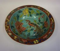 A Chinese Glazed Pottery Bowl, in the 18th century style, Decorated with a peacock in foliage,