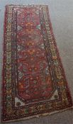 A Persian Hamadan Hand Knotted Runner, Decorated with multiple geometric and floral panels on a