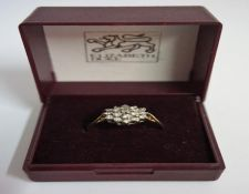 A 9ct Gold Diamond Cluster Ring, overall weight 2 grams