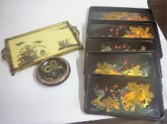 A Set Of Five Oriental Laquered Graduated Trays, Decorated with painted panels of dragons, largest