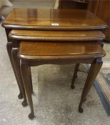 A Mahogany Nest Of Three Tables, raised on pad foot, 51cm high, also with a mahogany sofa type table