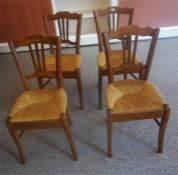 A Set Of Four Pear Wood Parlour Chairs, 20th century, with woven rush seats, 85cm high, (4)