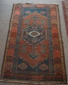 A Persian Saveh Hand Knotted Rug, Decorated with a large geometric medallion to the centre,