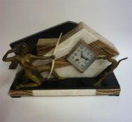 An Art Deco Marble Three Piece Clock Garniture, circa 1930s, comprising of a mantel clock with a