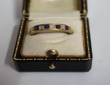 A 9ct Gold Diamond & Sapphire Seven Stone Ring, Comprising of three diamond stones and four sapphire