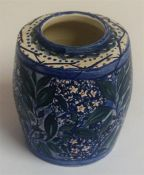 A Holyrood Art Pottery Cylindrical Pot, with allover glazed floral panels on a blue ground,