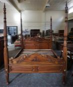 A Good Quality Reproduction Hardwood Four Poster Bed, with side rails and wooden slats, 222cm