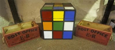 A Childs Rubix Cube Storage Box, 30cm, also with two Reproduction post office painted pine carry