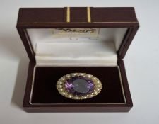A 9ct Gold Amethyst & Seed Pearl Ring, the large Amethyst measuring approximately 2cm diameter,